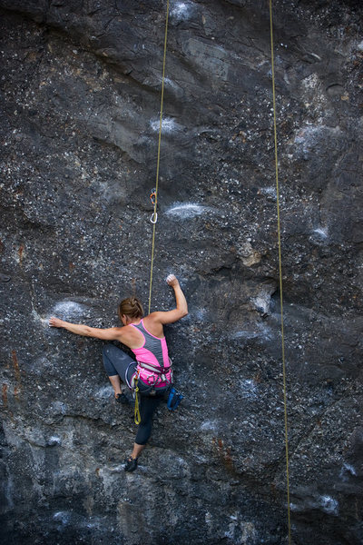 Katie works through the crux of Danger Boy, at Wheeler Gorge.