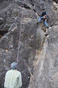 Rock Climbing Photo: A local boy rock climbing for the first time, topr...