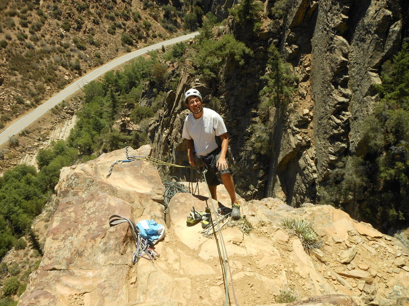 "The spacious belay at the base of ""Seven Steps To Heaven."""