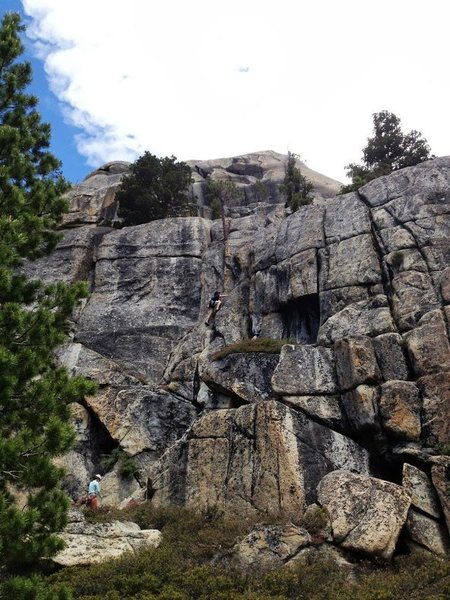 """Amy belay Alex up the central crack on """"New Peculiar."""" The Pacific Crest Trail is right off the bottom of the photo."""