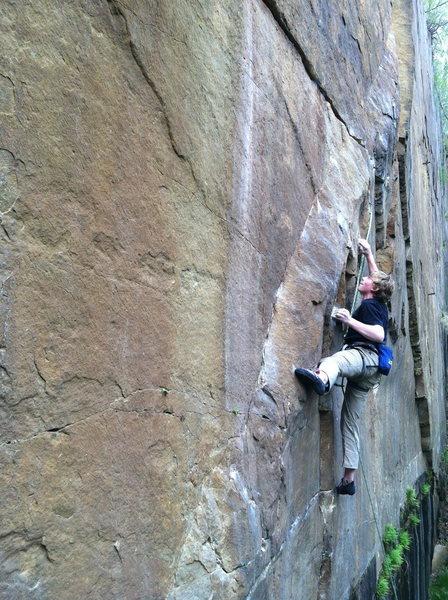 James Grenke working the beginning boulder problem.
