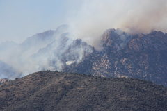Rock Climbing Photo: Firefighting crews in large helicopters working ha...
