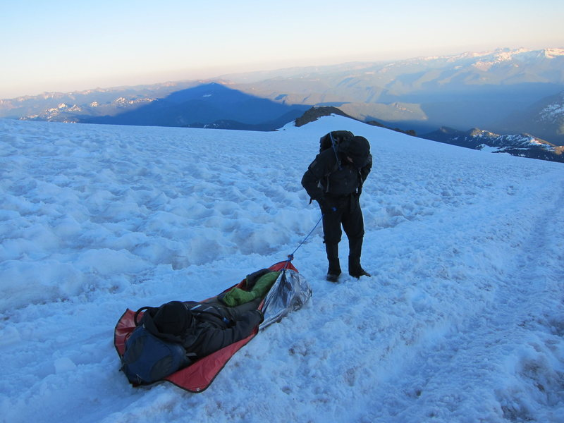 Anthony Vito Fiore Towing climber with severe leg cramps down Mount Rainier glacier as night fall sets.