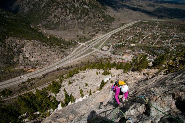 Julie Ellison cranking thru the headwall on Royal Flush, 5.9 on Mt. Royal.