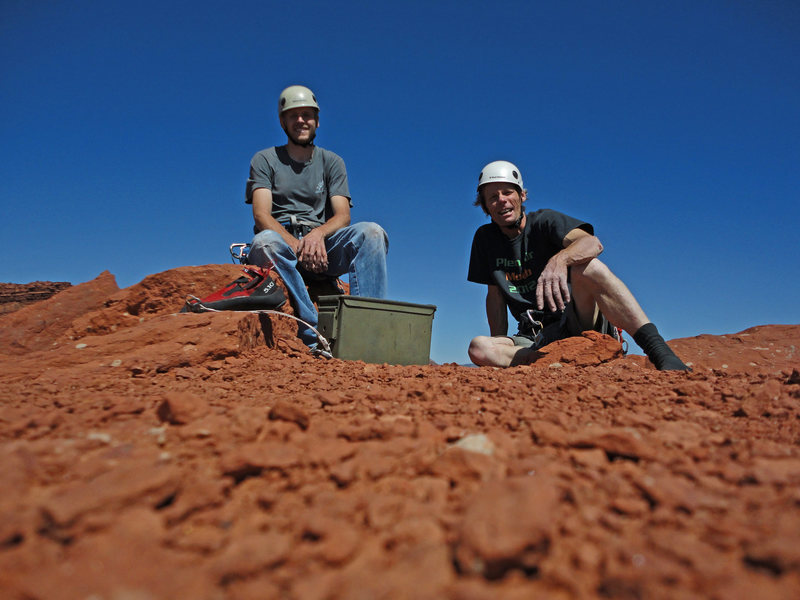 Low angle summit shot of Colby Wayment and Eric Zschiesche atop The Titan on a warm June day of 2013. Sans humans and gear,... with less atmospheric blue,... Mars? Classic formation,... though,... Zschiesche taxed with entertaining techniques ( aiding and jugging ) long rusty,.... was almost tempted to forego the last pitch and rappel. Clouds of consternation waned,... and the Sun baked summit felt the shadowed presence of members of the Tribe Primate....