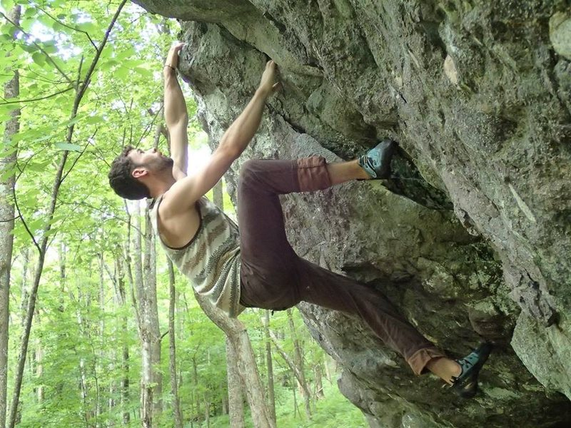 "Aaron Parlier warming up on ""Razorback Crack"" on the Pigs Boulder"