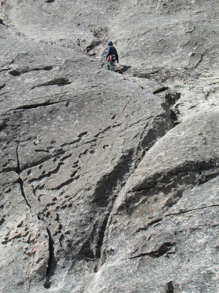 Climber at the common belay point for Cowboy, Cowgirl, and Easy Way Up routes.