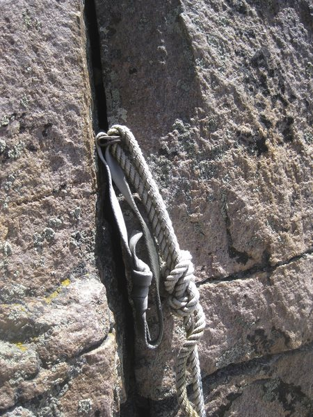 Fixed piton and rope.
