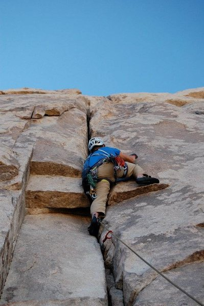 Using the small edges on the right face often overlooked by climbers new to this route.