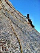 Matt face climbs out right on p2.