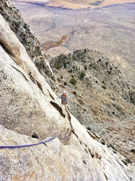 "Climber following ""crux"" traverse of pitch 5."