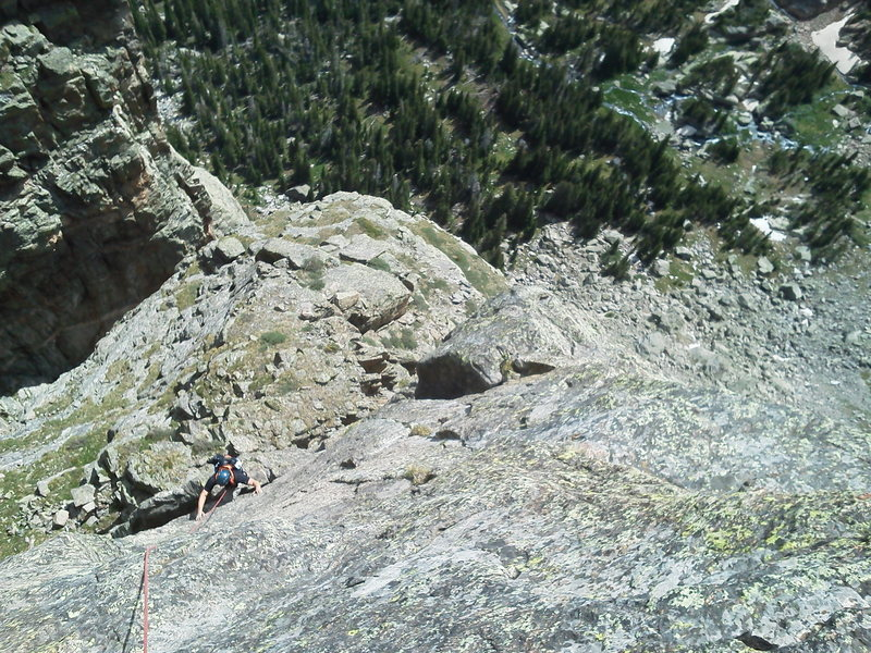 Travis Parigi climbing to the crux on pitch 1.