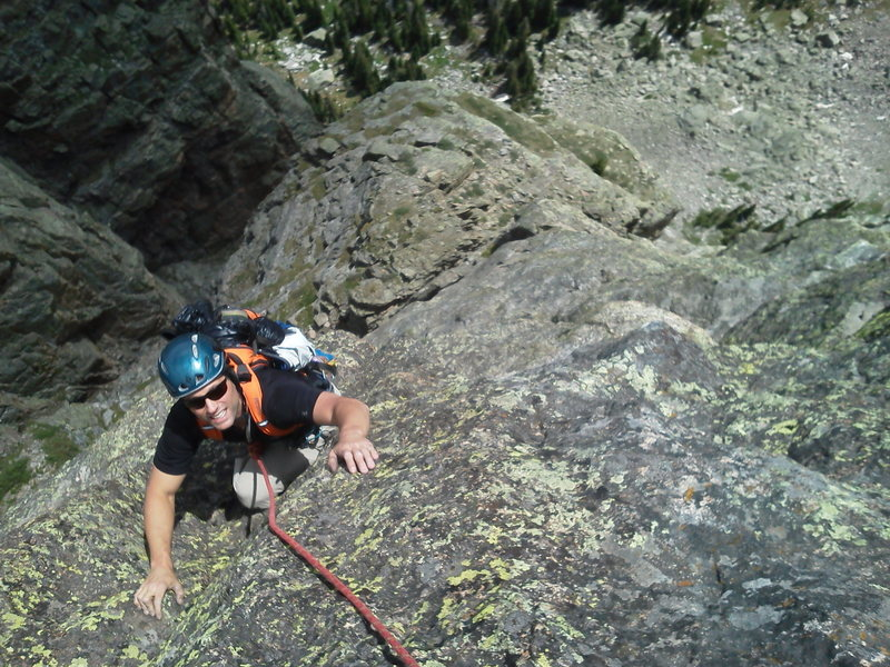 Travis Parigi just after pulling through the roof on P2@SEMICOLON@ top of the Second Buttress below.