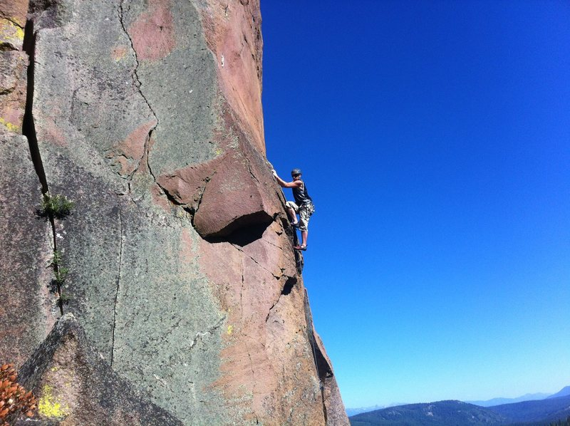 Laine exiting the crux and heading into the sustained face