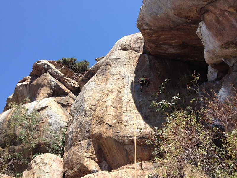 Rock Climbing Photo: Jessica trying to keep cool in the shade on Strang...