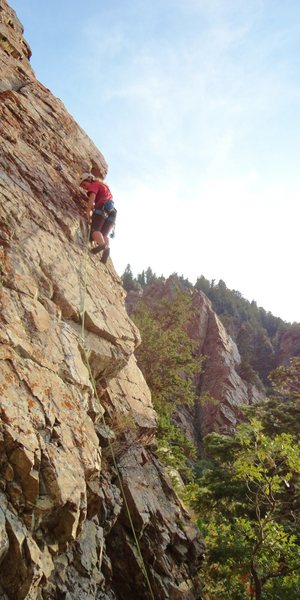 Rock Climbing Photo: Janie on the first pitch, clipping the third bolt.