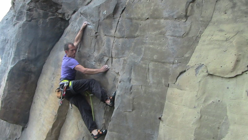 French climber Simon Flechaire pulling through the crux
