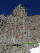 We scrambled up some 5th class stuff to a cordelette/webbing around a horn.  This is where we started our climb(allowed for an easy link up of pitches 1 & 2).  Pitch 2 (for us) started underneath the obvious twin cracks.  Our pitch 3 started from underneath a small roof.  You must traverse left into the chimney from here.  There's a piton in chimney right where the roof is.  We then scrambled to the top.  Dotted lines are behind rock in the picture.