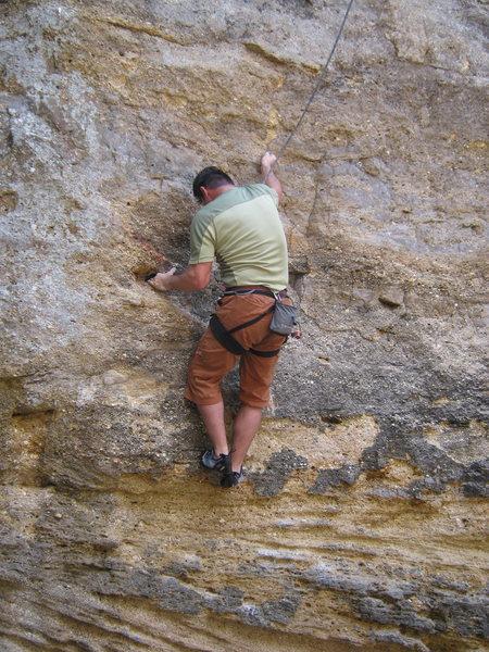 Rock Climbing Photo: Climber starting crux moves.