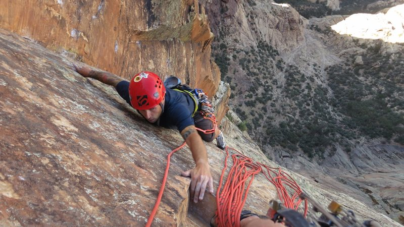 "Reaching for the much needed belay ""ledge"" in the Red Dihedrals."