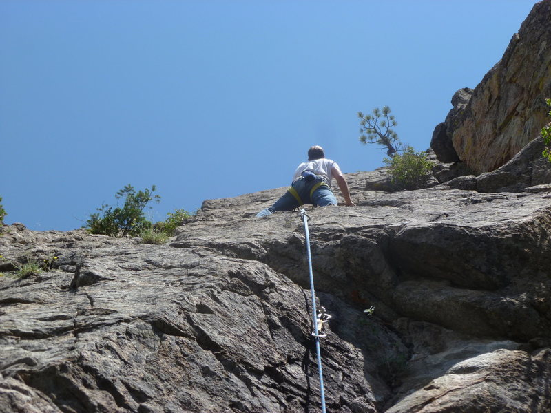 On the slab above the crux.