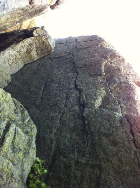 The route starts on the crack on the right then moves over to the thin broken crack in the center of the photo.  The route is mostly hard 10s with a move or two of 11.