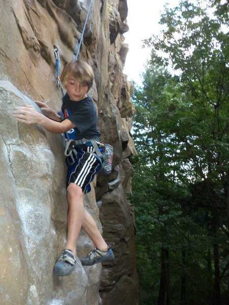 Rhys Schreck (age 9) negotiating the beginning moves of 5.10c above Classic Crack.