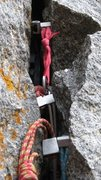 Rock Climbing Photo: Chuck Grossman one-handed stacked placements