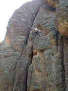Rock Climbing Photo: Climber moving into upper chimney from top of flak...