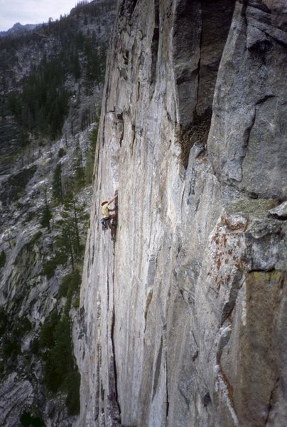 Me on the pitch 4 finger crack. From 1987, second ascent.