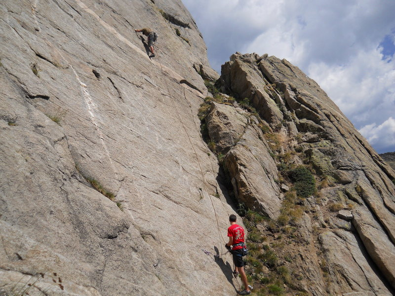 Rock Climbing Photo: Traversing out to the first bolt.