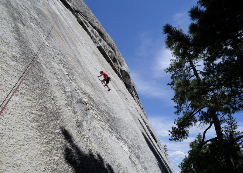 Doug Steigerwald is past the crux and cruising on the Good Samaritan (5.11+) at Dome Rock. <br> <br> The first 80 feet of this route are protected by 4 buttonheads--most mortals will want to lead Red Mushrooms and then enjoy this incredible climb on top rope.