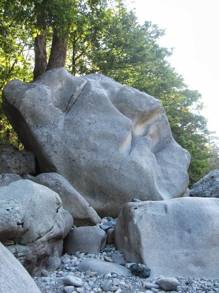 First boulder at river. The profile appears to be a head with squinting eyes looking up above the water.