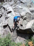 Rock Climbing Photo: George pulls through the crux before the 1st bolt.