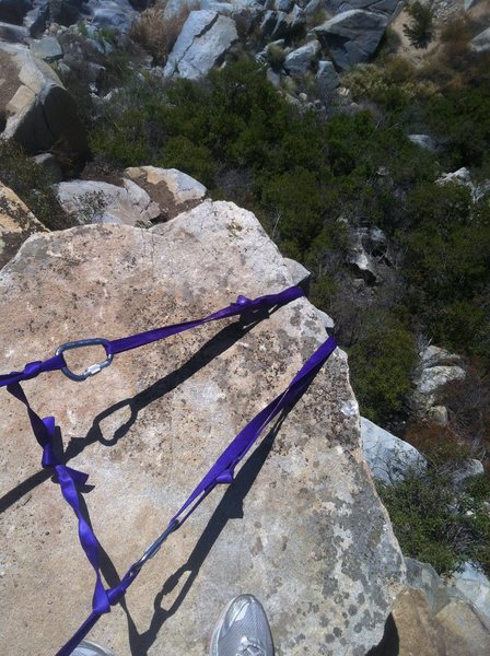 Webbing anchor set up for top rope. Recommend using 7mm cord there are sharp corners on the anchor boulders.