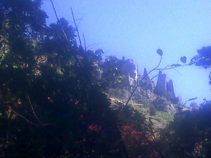 photo of Castledong Tower from the trail. It is the one on the right. Route goes up the shady face.