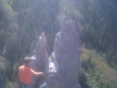 Rock Climbing Photo: stevie at the summit of Castledong Tower.