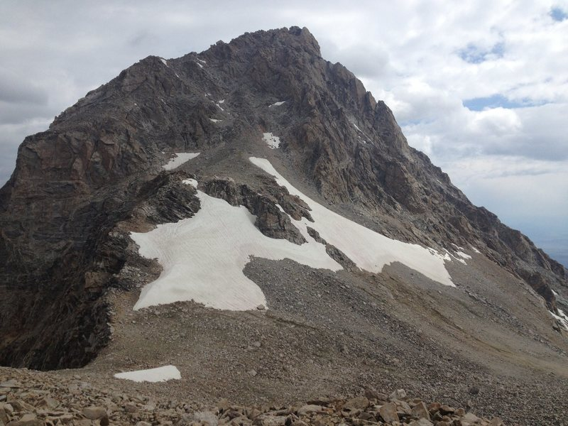 The upper couloir can be reached from a trail that goes up the south ridge from the saddle (lower left part of photo), or by cutting the corner and going up the snowfield/talus (lower right part of photo).