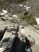 Rock Climbing Photo: Aubrey cleaning the last pitch of Lowe Route. This...