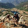 Scrambling up the last few feet to the summit. This route is classic because the feature and views are so awesome!