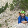 Erik Weihenmayer is psyched to have found the jug at the headwall roof! <br> <br> (photo: Charley Mace)