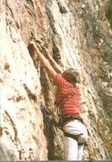 Layton Kor banging piton on lead on Limestone Wall by No Name, Glenwood Springs, CO .. 1987 or so.