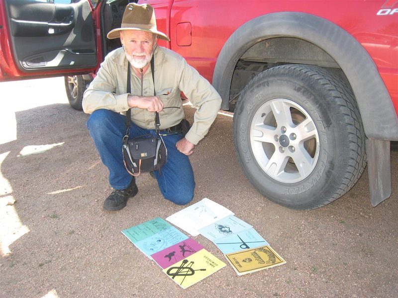 "Jim Halfpenny, author of the first Vedauwoo climbing guide in 1966, at a ""reunion"" of climbers at Vedauwoo, July 2013, with his collection of early guides."