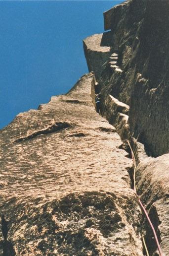Phil Gleason, 5.10 chimney variation. P4, Burgundy Spire North Face. 1998