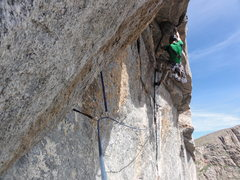 Nate Weitzel in the 11 hand crack through the roof. <br /> <br />Photo by Quinn Stevens.