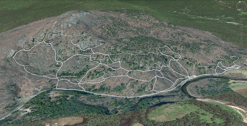 A Google Earth view of Rumney with trails mapped using GPS.<br> <br> The thicker lines are the major trails.  The thin lines are the minor trails.<br> The black lines are the individual crags.<br> <br> A more detailed satellite image was overlaid because it shows the exposed rock better.