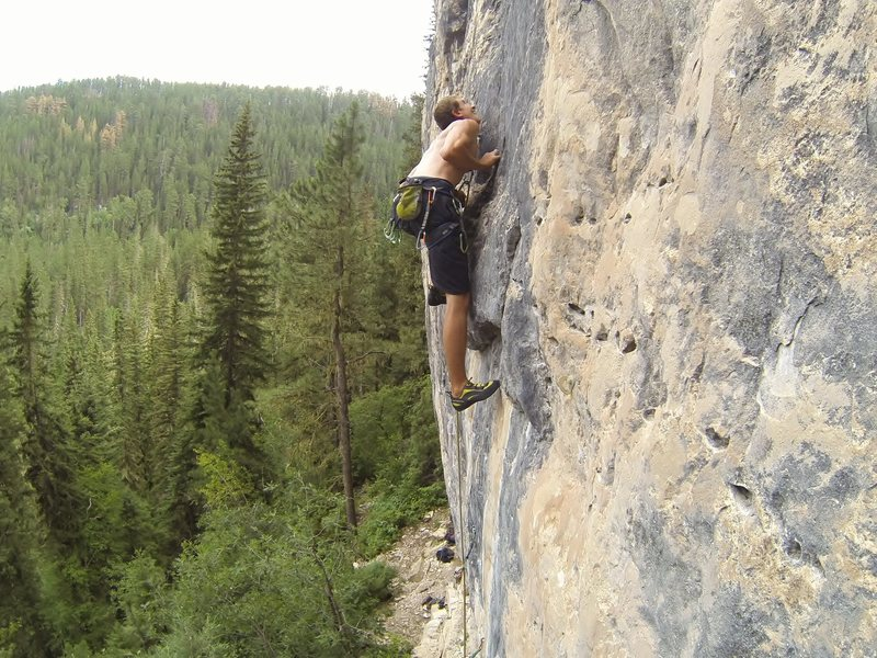 Just like Bruce Willis, Reggie slams explosive moves down on the rock that is bringing Armageddon, 5.12a<br> <br> Big Picture Wall, Big Picture Gully.<br> Spearfish, SD.