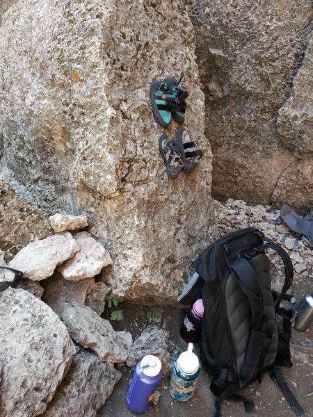 Shoes sticking to the slanted boulder at the base of Black Slabbath