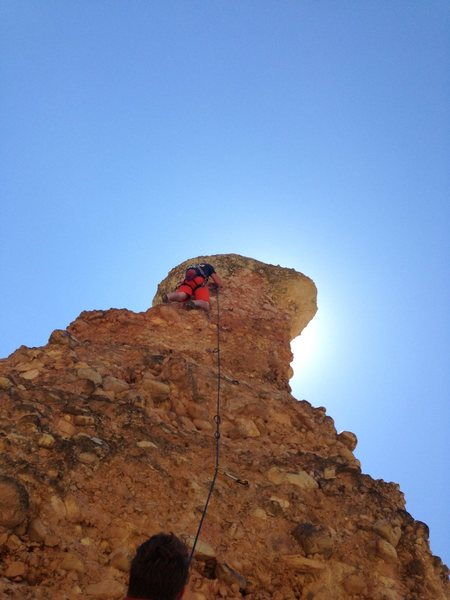 One more bolt, then the chains. Loose rock everywhere on these last moves, almost took out the belayer.