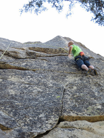 Rick just past the first crux of Powder Finger. Head up the right curving finger crack to gain the ledge.